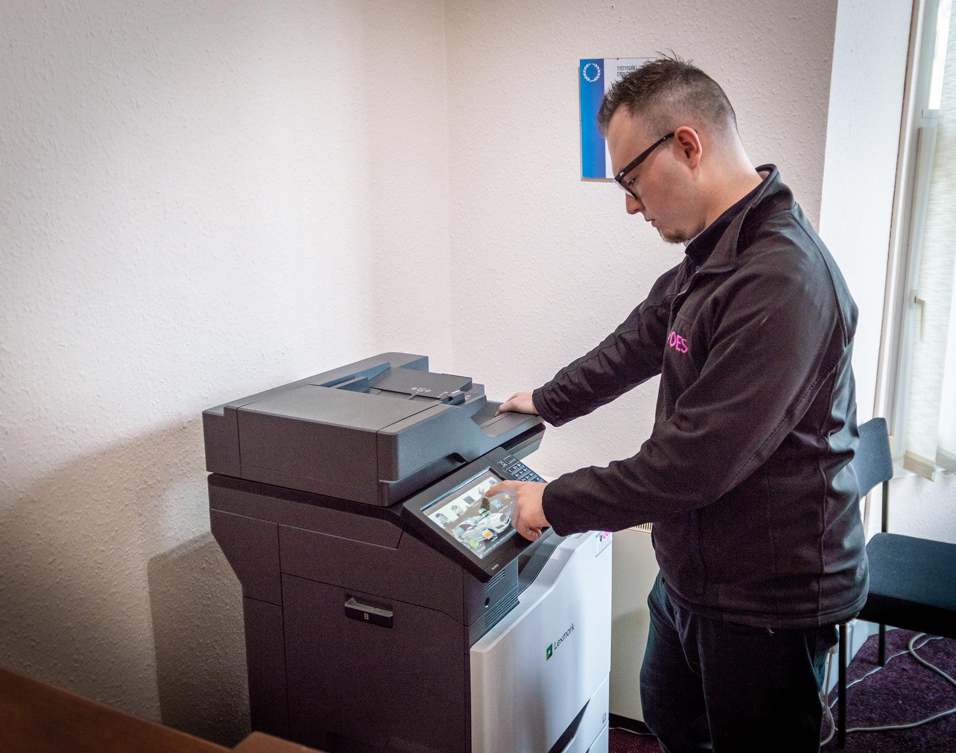 OES photocopier engineer working on an A3 Lexmark