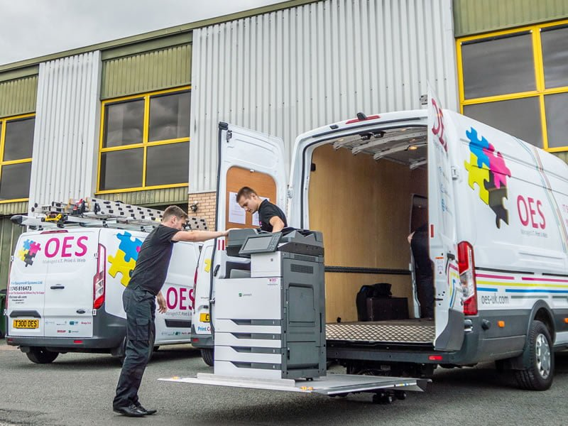 Lexmark photocopier loading into OES van for delivery